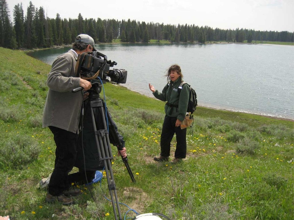 Volcanologist Lisa Morgan Morzel with a BBC crew in 2008 at Yellowstone National Park. The park's hot, bubbling mud pots, steaming vents and gushing geysers collectively comprise half of the planet's geothermal features, packed into less than 3,500 square miles. (Photo by Heidi Koontz)