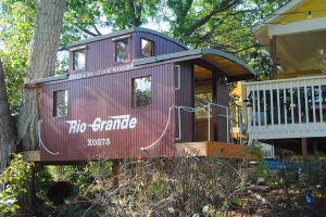 Helmstead designed and built this railroad-themed treehouse in a Louisville backyard. (photo courtesy Ed Helmstead)
