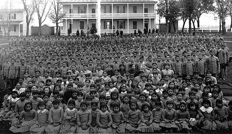 Pupils at institutions like the Carlisle Indian Industrial School rarely saw their families and returned home with PTSD-like symptoms. Many never returned; the school recorded almost 500 deaths and 1,842 escapes between 1883 and 1918. (photo courtesy National Anthropological Archives, Smithsonian Institution)