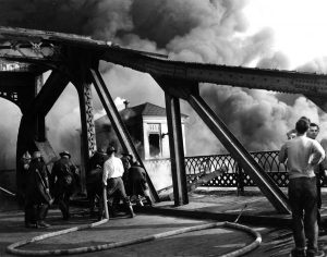 Firemen battle a fire on Cleveland's Cuyahoga River in 1952. The river burned several times during the 1940s, '50s and '60s, once reportedly because a spark from a passing train ignited oily debris on the water. The last big fire, in 1969, awoke Laurie Dameron, then 9, to the horror of desecrating the Earth. (Photo courtesy of Michael Schwartz Library, Cleveland State University)