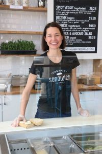 Marcy Miller constructs one of her signature sammies at east Pearl's fast-casual Organic Sandwich Company. (photo by George Lange)