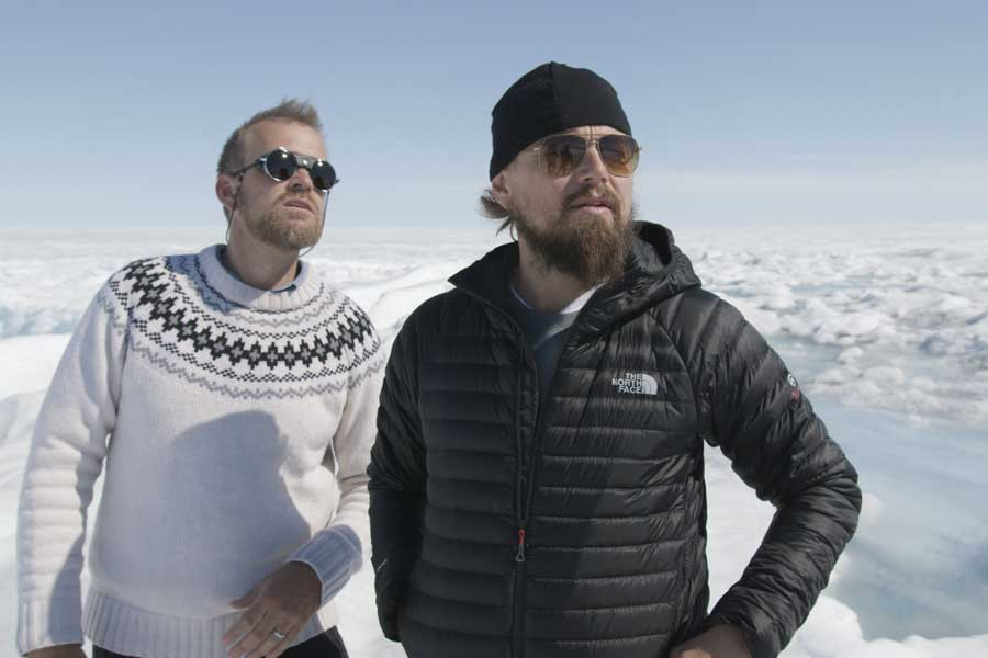 Celebrities can drive public climate discussions in positive or negative directions. Movie star Leonardo DiCaprio (right) is a climate-change advocate who has traveled worldwide to witness the effects of climate change. DiCaprio is pictured with former Boulder climate scientist Dr. Jason E. Box on the Greenland ice sheet in 2016. (photo © 2016 RatPac Documentary Films, LLC and Greenhour) Corporation, Inc.