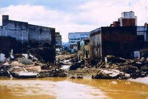Flood damage along the Choluteca River in Tegucigalpa, Honduras, caused by Hurricane Mitch in 1998. Over 9,000 deaths and 9,000 missing were attributed to Mitch, making it the second-most deadly hurricane in history, ranking only below a 1780 hurricane in the Lesser Antilles. (photo by Debbie Larson, NWS International Activities, NOAA Photo Library)